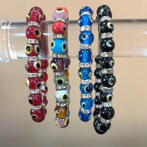 Jewelry - 4 Stretch evil eye bracelets with crystals